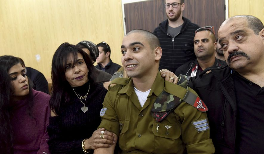 Israeli soldier Sgt. Elor Azaria attends a sentencing hearing in the military court surrounded by his family, in Tel Aviv, Israel, in this Jan. 24, 2017, file photo. (Debbie Hill, Pool via AP, File)