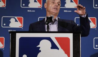 Major League Baseball Commissioner Rob Manfred answers questions at a news conference Tuesday, Feb. 21, 2017, in Phoenix. (AP Photo/Morry Gash)