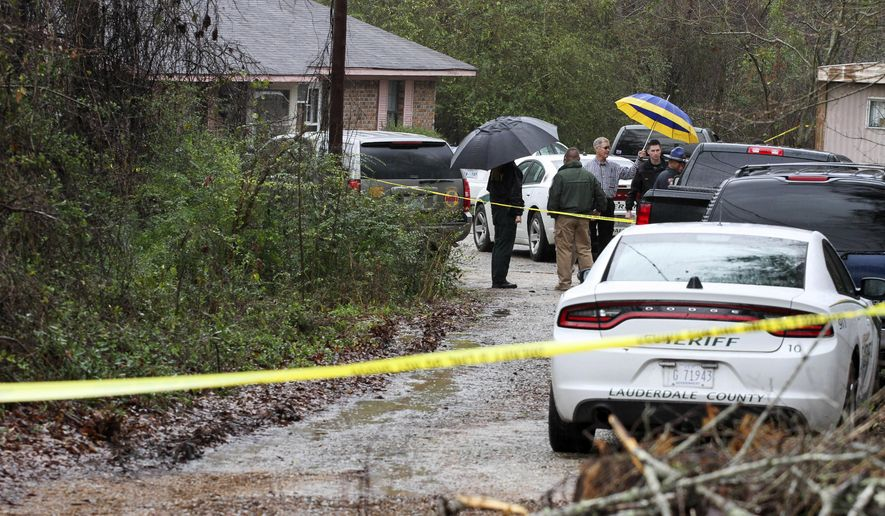 Lauderdale County authorities investigate the shooting deaths of four members of a family in Toomsuba, Miss., Tuesday, Feb. 21, 2017. (Paula Merritt /The Meridian Star via AP)