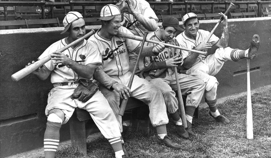 FILE - In this Sept. 30, 1938 file photo, Rip Collins, Chicago first baseman and former Cardinal, joined his old teammates in a burlesque of John Pepper Martin's mudcat band in St. Louis, from left, Stan Bordagaray, Bill McGee, Collins, and Pepper himself are dancing out a on their bats, while Bob Weiland (standing, rear) finds his glove sufficient. The Abraham Lincoln Presidential Museum plans to unveil an exhibit chronicling the history of the rivalry between the Chicago Cubs and the St. Louis Cardinals opens March 24, 2017 in Springfield, Ill. (AP Photo File)