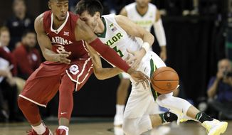 Baylor guard Jake Lindsey, right, collides with Oklahoma's Christian James, left, chasing down a loose ball in the first half of an NCAA college basketball game, Tuesday, Feb. 21, 2017, in Waco, Texas. (AP Photo/Tony Gutierrez)