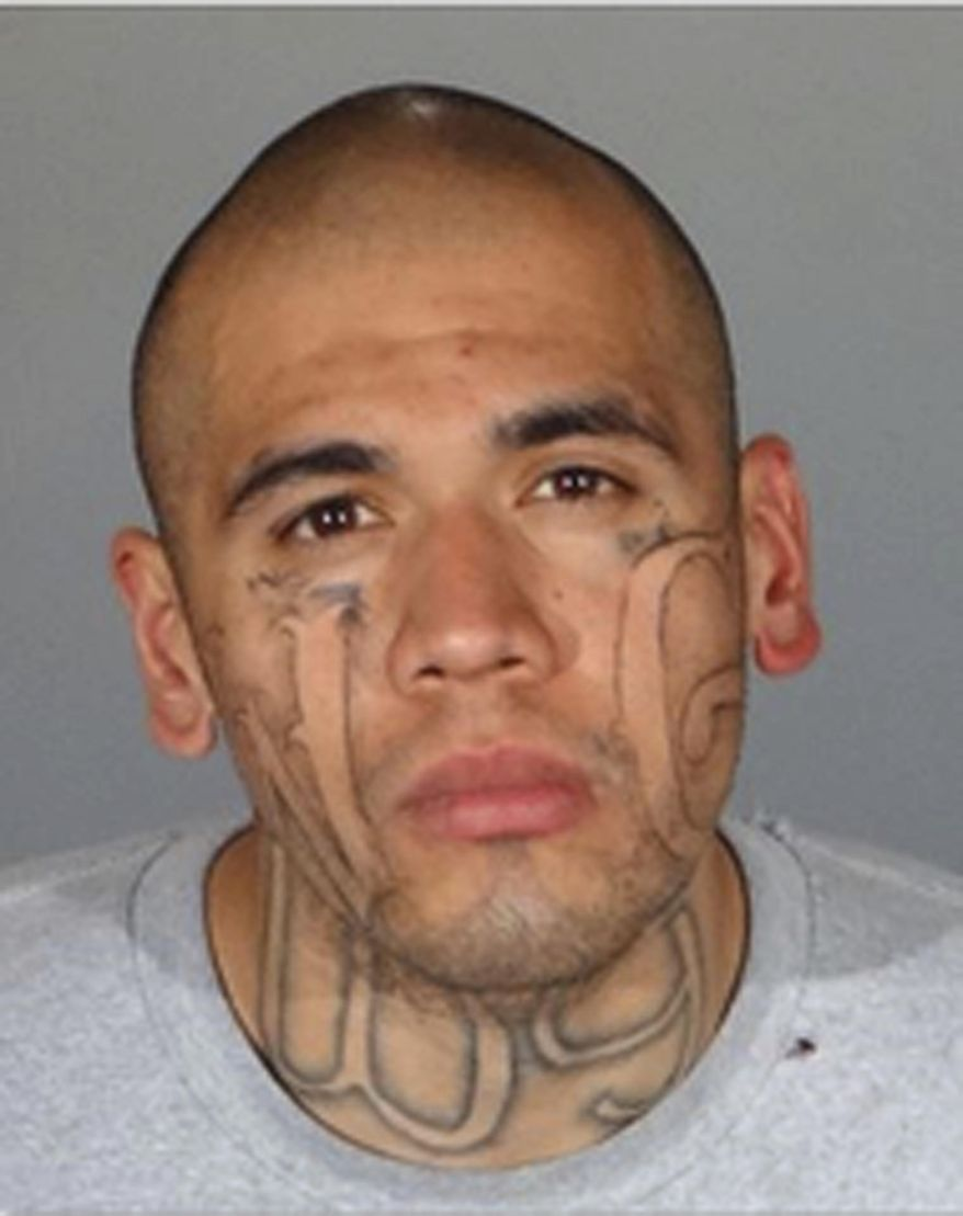 This undated booking photo provided by the Los Angeles County Sheriff's Department shows Michael Christopher Mejia, 26. Authorities have identified Mejia as the suspect they say fatally shot Whittier, Calif., police officer Keith Boyerand injured another as the officers responded to a traffic accident Monday, Feb. 20, 2017. Authorities say Mejia is a known gang member who was recently released from jail. (Los Angeles County Sheriff's Department via AP)