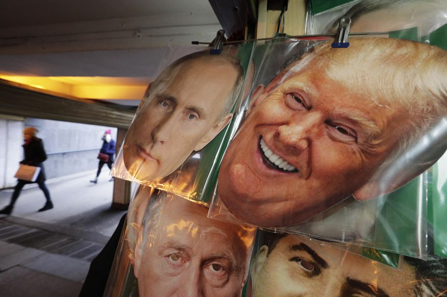 In this Monday, Feb. 20, 2017 photo face masks depicting Russian President Vladimir Putin and US President Donald Trump hang on sale at a souvenir street shop in St.Petersburg, Russia. The Kremlin refrained from comment Tuesday, Feb. 21, 2017 on the appointment of the new U.S. national security adviser Army Lt. Gen. H.R. McMaster, but one lawmaker said he was likely to take a hawkish stance toward Russia. (AP Photo/Dmitri Lovetsky)