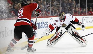 Ottawa Senators goalie Craig Anderson (41) leaves the crease to defend against New Jersey Devils left wing Taylor Hall (9) during the second period of an NHL hockey game, Tuesday, Feb. 21, 2017, in Newark, N.J. (AP Photo/Julio Cortez)