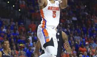Florida's KeVaughn Allen shoots against South Carolina during the first half of an NCAA college basketball game Tuesday, Feb. 21, 2017, in Gainesville, Fla. (AP Photo/Matt Stamey)