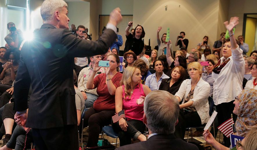 Republicans have experienced raucous booing at town hall-style events courtesy of agitators of the left who are digging in against any of President Trump's policies. The activists say this is similar to what the tea party did under former President Barack Obama. (Associated Press)