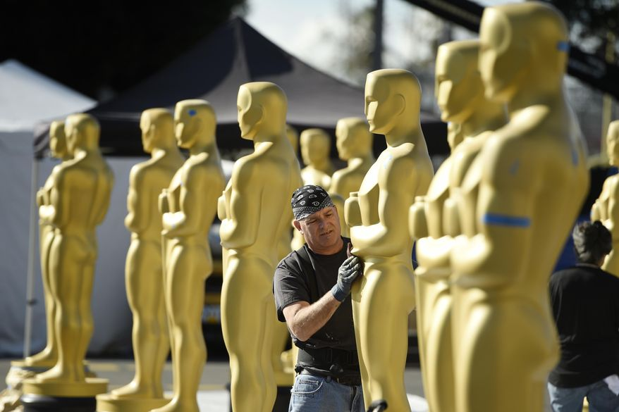 Scenic artist Rick Roberts of Local 800 primps Oscar statues near the Dolby Theatre on Wednesday, Feb. 22, 2017, in Los Angeles. The 89th Academy Awards will be held on Sunday. (Photo by Chris Pizzello/Invision/AP)
