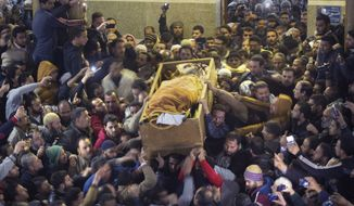 Relatives and friends of Sheik Omar Abdel-Rahman, who was convicted of plotting terror attacks in New York City in the decade before 9/11, carry his coffin after funeral prayers at the Grand Mosque, in the Nile Delta town of Gamalia, Egypt, Wednesday, Feb. 22, 2017. Abdel-Rahman, the so-called Blind Sheikh, was arrested in 1993 and convicted in 1995 along with nine followers of a conspiracy to blow up the United Nations and several New York landmarks. A symbol for radical Islamists, he had been serving a life sentence in a U.S. prison when he died on Saturday. (AP Photo/Amr Nabil)