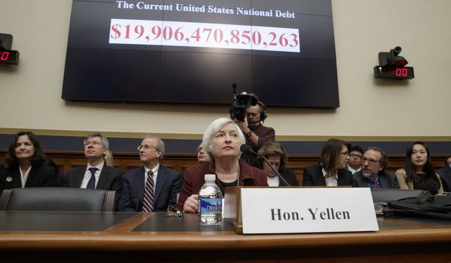"FILE - In this Feb. 15, 2017 file photo, Federal Reserve Chair Janet Yellen testifies on Capitol Hill in Washington before the House Financial Services Committee for the Fed's semi-annual Monetary Policy Report to Congress.  Federal Reserve officials earlier this month discussed the need to raise a key interest rate again ""fairly soon,"" especially if the economy remains strong. Minutes of the discussions in minutes released Wednesday, Feb. 22  showed that while Fed officials decided to keep a key rate unchanged at their Jan. 31-Feb. 1 meeting, there was growing concern about what could happen to inflation if the economy out-performed expectations. (AP Photo/J. Scott Applewhite)"