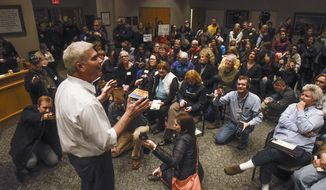 U.S. Rep. Tom Emmer answers a question near the end of a town hall meeting in Sartell, Minn., Wednesday, Feb. 22, 2017. Emmer's town hall went on as planned after the congressman said he would shut down the event if protests or unruly attendees disrupted the conversation. (Dave Schwarz/St. Cloud Times via AP)