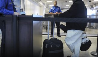 FILE - In this Jan. 6, 2010 file photo, a TSA employee being trained in behavioral pattern recognition watches passengers in line at a security checkpoint at Logan International Airport in Boston. Two planes departing Boston on Sept. 11, 2001, were hijacked and crashed into the World Trade Center in New York. A breach that allowed 11 people to walk through an unattended security checkpoint lane at New York's JFK International Airport Monday, Feb. 20, 2017 has some questioning how it could happen after the battery of security measures put in place after the Sept. 11 terror attacks. (AP Photo/Josh Reynolds, File)