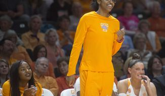 Tennessee's Diamond DeShields supports her teammates from the bench during the second half of an NCAA college basketball game against Arkansas in Knoxville, Tenn., on Sunday, Feb. 19, 2017. (Saul Young/Knoxville News  Sentinel via AP)