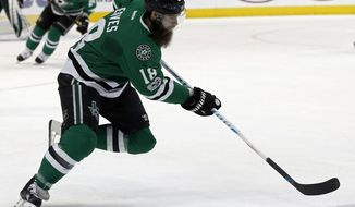 FILE - In this Feb. 11, 2017, file photo, Dallas Stars' Patrick Eaves (18) skates up ice with the puck against the Carolina Hurricanes during an NHL hockey game in Dallas. The NHL trade deadline is looming over the league, leading to players such as Detroit Red Wings defenseman Brendan Smith and forward Thomas Vanek wondering if they will be dealt. Both players have expiring contracts, making them attractive on the market, along with Arizona's Martin Hanzal, Dallas' Eaves and Tampa Bay's Ben Bishop. (AP Photo/Mike Stone, File)