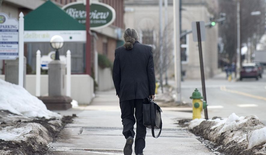 Tony Moreno's defense attorney Norman A. Pattis leaves Middlesex Superior Court on Wednesday, Feb. 22, 2017,  following the guilty verdict of his client in Middletown, Conn.  Moreno threw 7-month-old Aaden off the Arrigoni Bridge that spans the Connecticut River between Middletown and Portland on July 15, 2015, and then jumped intending to kill himself, prosecutors said.  (Patrick Raycraft/Hartford Courant via AP, Pool)