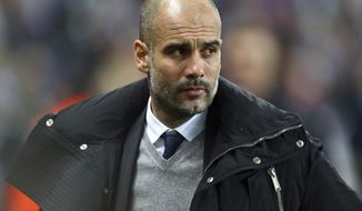 Manchester City's manager Pep Guardiola arrives for the Champions League round of 16 first leg soccer match between Manchester City and Monaco at the Etihad Stadium in Manchester, England, Tuesday Feb. 21, 2017. (AP Photo/Dave Thompson)