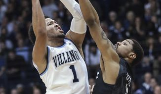 Villanova's Jalen Brunson gets fouled by Butler's Kethan Savage during the first half of an NCAA college basketball game Wednesday, Feb. 22, 2017, in Villanova, Pa. (Steven M. Falk/The Philadelphia Inquirer via AP)