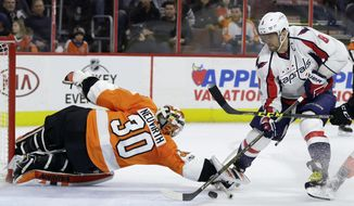 Washington Capitals' Alex Ovechkin (8) cannot get a shot in goal past Philadelphia Flyers' Michal Neuvirth (30) during the third period of an NHL hockey game, Wednesday, Feb. 22, 2017, in Philadelphia. Washington won 4-1. (AP Photo/Matt Slocum)