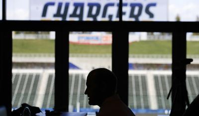 Los Angeles Chargers offensive coordinator Ken Whisenhunt is silhouetted as he talks to a reporter after a news conference Wednesday, Feb. 22, 2017, in Carson, Calif. (AP Photo/Jae C. Hong)
