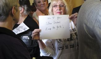 A supporter of U.S. Sen. Steve Daines holds up a sign before a news conference in the Montana Capitol in Helena Wednesday, Feb. 22, 2017. Hundreds of demonstrators rallied at the Capitol a day earlier to demand that Daines hold a town hall meeting with them, but the Republican senator rescheduled his appearance until Wednesday, drawing fewer protesters. Republicans who benefited from rowdy town halls six years ago and harnessed a wave of discontent with Democrats to win seats in Congress are learning a hard lesson this week as they return home: The left is happy to return the favor. (AP Photo/Matt Volz)