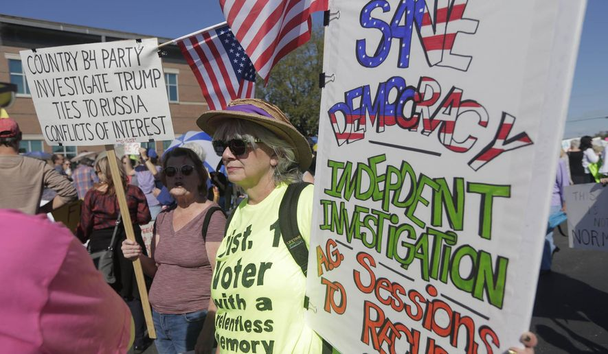 People hold a rally outside Sen. Bill Cassidy's town hall meeting in Metairie, La., Wednesday, Feb. 22, 2017. (Andrew Boyd/NOLA.com The Times-Picayune via AP)