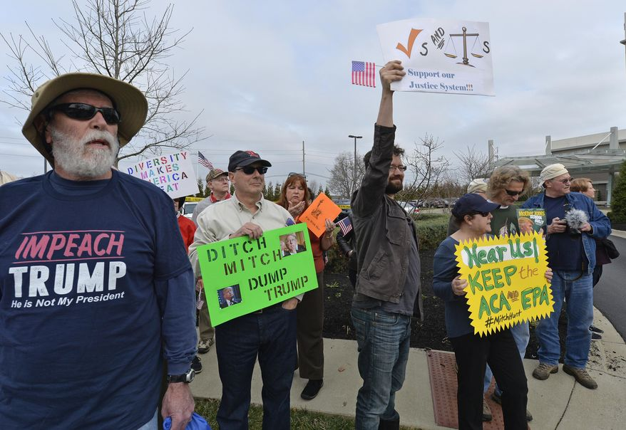 A group numbering in the hundreds gather to protest the appearance of Senate Majority Leader Mitch McConnell R-Ky., and the policies of the Trump administration outside of the Jeffersontown Chamber of Commerce luncheon, Wednesday, Feb. 22, 2017, in Jeffersontown, Ky. (AP Photo/Timothy D. Easley)