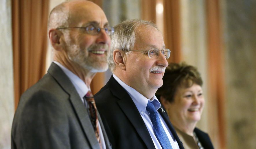 Speaker of the House Frank Chopp, D-Seattle, center, stands with Rep. Larry Springer, D-Kirkland, left, and Rep. Judy Clibborn, D-Mercer Island, right, near the wings of the House floor Wednesday, Feb. 22, 2017, during debate over education funding at the Capitol in Olympia, Wash. The House approved its education funding proposal Wednesday, just weeks after the Republican-led Senate passed its own plan. Both sides will now need to negotiate a final compromise. Lawmakers are working to comply with a 2012 state Supreme Court ruling that they must fully fund the state's basic education system. (AP Photo/Ted S. Warren)