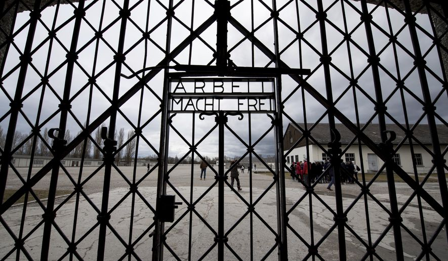 A copy of the historic gate of the memorial site of the former concentration camp Dachau is photographed in Dachau, Germany, Wednesday Feb. 22, 2017. (Sven Hoppe/dpa via AP)
