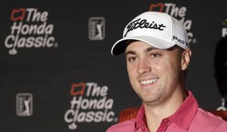 Justin Thomas smiles as he talks to reporters at the Honda Classic golf tournament practice, Wednesday, Feb. 22, 2017, in Palm Beach Gardens, Fla. (AP Photo/Alan Diaz)