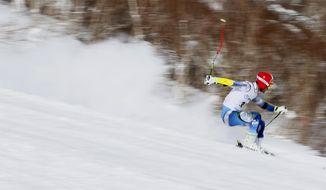 Tajikistan's Barakatullo Zokirov competes in the alpine skiing men's giant slalom at the Asian Winter Games in Sapporo, northern Japan, Wednesady, Feb. 22, 2017. (AP Photo/Shuji Kajiyama)