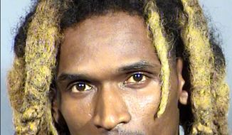This undated Clark County Detention Center booking photo shows Moises Johnson, of West Palm Beach, Fla. Police say Johnson was arrested Tuesday, Feb. 21, 2017, pending a court appearance on felony assault and weapon charges after a gunshot was fired in the air during a fight between the three-member hip hop music group Migos and rapper Sean Kingston outside a Las Vegas Strip conference venue. No injuries were reported. (Clark County Detention Center/Las Vegas Metropolitan Police Department via AP)