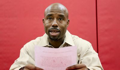 FILE- In this Aug. 19, 2016, file photo, Nebraska receivers coach Keith Williams reads a statement about his drunken driving arrest and suspension from coaching duties during an NCAA college football news conference at Hawks Championship Center in Lincoln, Neb. On Wednesday, Feb. 22, 2017, Williams was sentenced to 30 days in jail and fined $1,000 after pleading no contest to third-degree drunken driving. Williams is to report to jail on March 3, but a Lancaster County judge said Williams could apply for house arrest. Williams was arrested after rear-ending a vehicle in August, and Cornhuskers coach Mike Riley suspended him for the first four games of the 2016 season. (AP Photo/Nati Harnik, file)