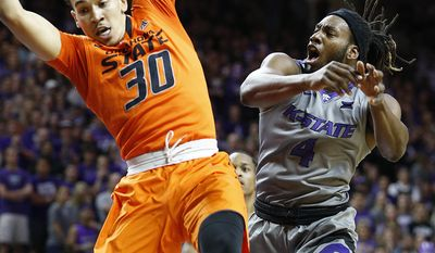 Oklahoma State guard Jeffrey Carroll (30) grabs a rebound as he battles with Kansas State forward D.J. Johnson (4) during an NCAA college basketball game, Wednesday, Feb. 22, 2017, in Manhattan, Kan. (Bo Rader/The Wichita Eagle via AP)