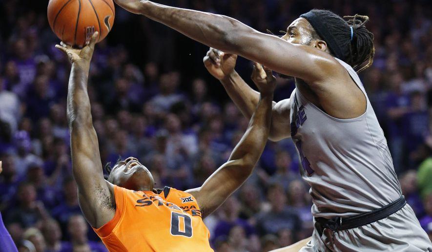 Kansas State forward D.J. Johnson (4) stops a shot by Oklahoma State guard Brandon Averette (0) during an NCAA college basketball game, Wednesday, Feb. 22, 2017, in Manhattan, Kan. (Bo Rader/The Wichita Eagle via AP)