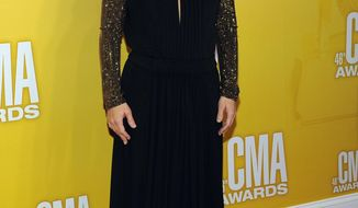 FILE - In this Thursday, Nov. 1, 2012, file photo, Lisa Marie Presley arrives at the 46th Annual Country Music Awards at the Bridgestone Arena in Nashville, Tenn. A Los Angeles judge on Wednesday, Feb. 22, 2017, ruled that Presley must pay $50,000 to her estranged husband's attorney in their messy divorce case, but that she does not have to pay him spousal support until other issues in the case are resolved. (Photo by Chris Pizzello/Invision/AP, File)