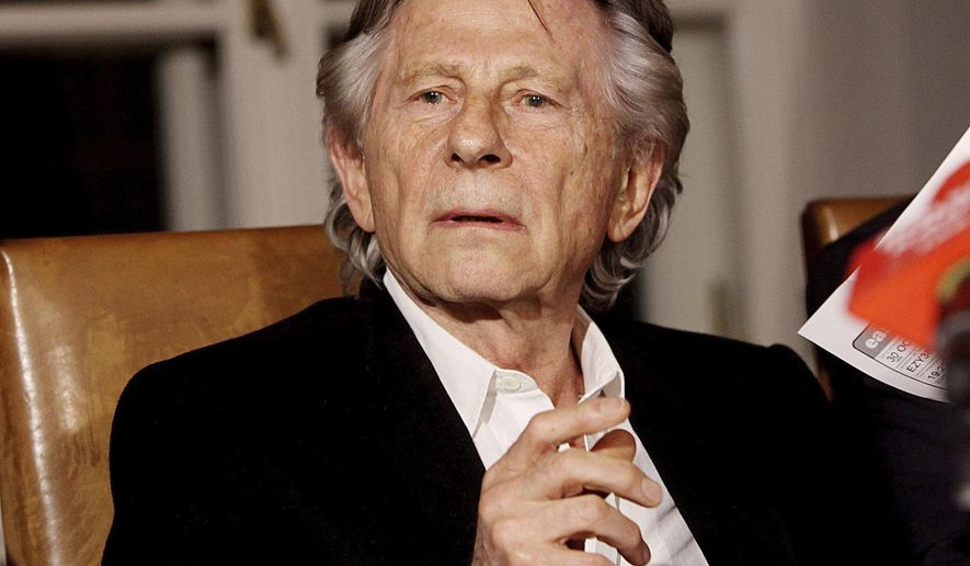 FILE - In this Oct. 30, 2015 file photo, filmmaker Roman Polanski talks to reporters in Krakow, Poland, after a Polish judge ruled that Polish law forbids his extradition to the U.S., where in 1977 he pleaded guilty to having had sex with a minor. A hearing to unseal testimony in Polanski's long-running underage sex case has been delayed. The Los Angeles Superior Court sent out a notice Wednesday, Feb. 22, 2017, that a hearing scheduled for Friday has been delayed a new date has not yet formally been set. (AP Photo/Jarek Praszkiewicz, File)