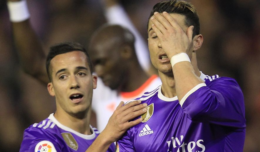 Real Madrid's Cristiano Ronaldo, right, and Real Madrid's Lucas Vazquez, left, react after failing to score against Valencia during the Spanish La Liga soccer match between Valencia and Real Madrid at the Mestalla stadium in Valencia, Spain, Wednesday, Feb. 22, 2017. (AP Photo/Alberto Saiz)