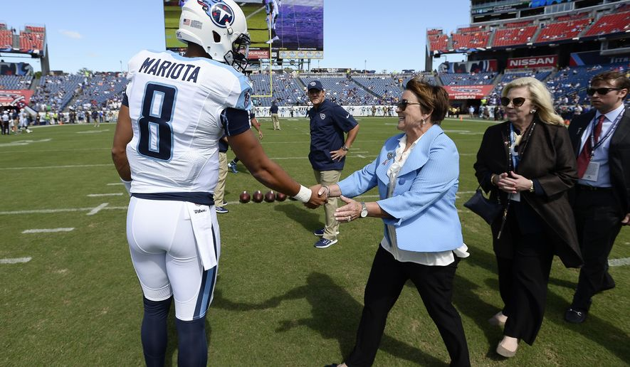 FILE -- In this Sept. 11, 2016 file photo, Tennessee Titans quarterback Marcus Mariota (8) greets Titans owner Amy Adams Strunk, center, before an NFL football game against the Minnesota Vikings in Nashville, Tenn. A year ago, Strunk could only promise hope to Tennessee season-ticket holders. Now the general manager and coach she hired went 9-7 in their first season and lots of ammunition to build with as they meet with season-ticket holders Wednesday night. (AP Photo/Mark Zaleski, File)
