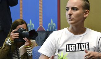 """FILE - This May 31, 2016, file photo Brit Hoagland, right, talks during a news conference in Denver. Hoagland along with six plaintiff's filed a law suite challenging Fort Collins' indecency code. A Colorado judge on Tuesday, Feb. 21, 2017 has put on hold the college town's law against women going topless. U.S. District Judge R. Brooke Jackson said that he is """"likely"""" to find Fort Collins' ordinance unconstitutional. The indecency code makes it a crime for women but not men to show their nipples. (AP Photo/P. Solomon Banda ,File)"""