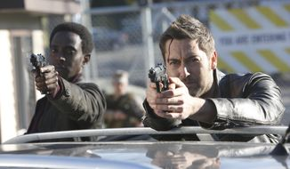"""This image released by NBC shows Edi Gathegi as Solomon, left, and Ryan Eggold as Tom Keen in a scene from """"The Blacklist: Redemption."""" (Will Hart/NBC via AP)"""