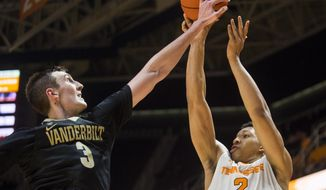 Tennessee's Grant Williams (2) has a shot blocked by Vanderbilt's Luke Kornet (3) during an NCAA college basketball game Wednesday, Feb. 22, 2017, in Knoxville, Tenn. (Brianna Paciorka/Knoxville News Sentinel via AP)