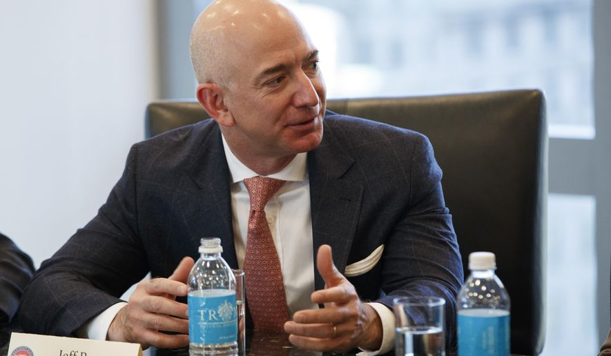 """FILE - In this Dec. 14, 2016 file photo, Amazon founder and CEO  Jeff Bezos, speaks during a meeting with then-President-elect Donald Trump and technology industry leaders at Trump Tower in New York.  The Washington Post is featuring a new motto on the paper's website: """"Democracy Dies in Darkness."""" The words now appear underneath the name of the paper on its website. They were not, however, in a similar place in the paper's print edition Wednesday, Feb. 22, 2017, Bezos used the phrase in an interview last year when asked to explain why he purchased the paper in 2013.  (AP Photo/Evan Vucci, File)"""
