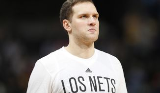 This March 4, 2016 photo shows Brooklyn Nets guard Bojan Bogdanovic in the second half of an NBA basketball game in Denver. A person familiar with the deal says the Washington Wizards have agreed to acquire Bogdanovic from the Brooklyn Nets. The person spoke to The Associated Press on condition of anonymity on Wednesday, Feb. 22, 2017 because the trade had not been announced. (AP Photo/David Zalubowski)