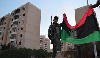 Fighters from the Libyan National Army, led by Khalifa Haftar, celebrated this month after Garyounis was reopened to civilians. Garyounis is an administrative division of Benghazi, Libya. (By Mathieu Galtier/Special to The Washington Times)