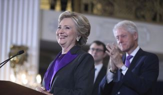 In this Nov. 9, 2016, file photo, former President Bill Clinton applauds as his wife, Democratic presidential candidate Hillary Clinton, speaks in New York. (AP Photo/Andrew Harnik, File)