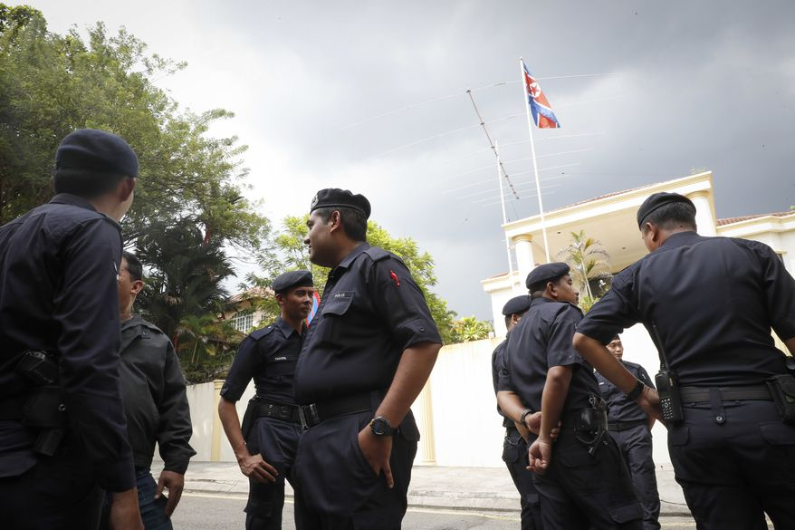 """Malaysian Police stand outside North Korean Embassy in Kuala Lumpur, Malaysia, Thursday, Feb. 23, 2017. North Korea denied Thursday that its agents masterminded the assassination of the half brother of leader Kim Jong Un, saying a Malaysian investigation into the death of one of its nationals is full of """"holes and contradictions."""" (AP Photo/Vincent Thian)"""