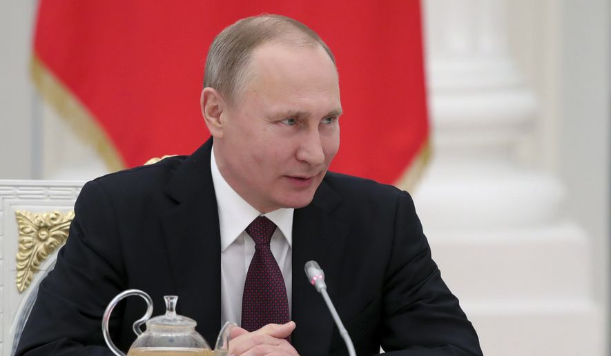"""Russian President Vladimir Putin at a meeting with Russian seamen in Moscow, Russia, Thursday, Feb. 23, 2017. Putin is voicing hope for the success of a political settlement in Syria, saying it will help defeat the """"terrorist malaise."""" (Mikhail Klimentyev, Sputnik, Kremlin Pool Photo via AP)"""