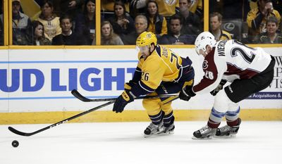 Colorado Avalanche defenseman Patrick Wiercioch (28) slows down Nashville Predators left wing Harry Zolnierczyk (26) during the second period of an NHL hockey game Thursday, Feb. 23, 2017, in Nashville, Tenn. (AP Photo/Mark Humphrey)