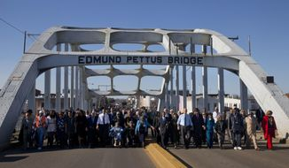 """FILE - In this March 7, 2015, file photo, President Barack Obama, first lady Michelle Obama, their daughters Malia and Sasha, as well as members of Congress, former President George W. Bush, and civil rights leaders make a symbolic walk across the Edmund Pettus Bridge in Selma, Ala., on the 50th anniversary of """"Bloody Sunday,"""" a civil rights march in which protestors were beaten, trampled and tear-gassed by police at the site. Blacks who celebrate the civil rights movement and whites who commemorate the Civil War are suddenly finding themselves fighting on the same side in historic Selma, Alabama: against City Hall. (AP Photo/Jacquelyn Martin, File)"""