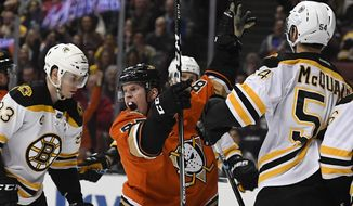 Anaheim Ducks right wing Ondrej Kase, center, of the Czech Republic, celebrates a goal by defenseman Josh Manson as Boston Bruins left wing Peter Cehlarik, left, of Slovakia, and defenseman Adam McQuaid react during the second period of an NHL hockey game, Wednesday, Feb. 22, 2017, in Anaheim, Calif. (AP Photo/Mark J. Terrill)