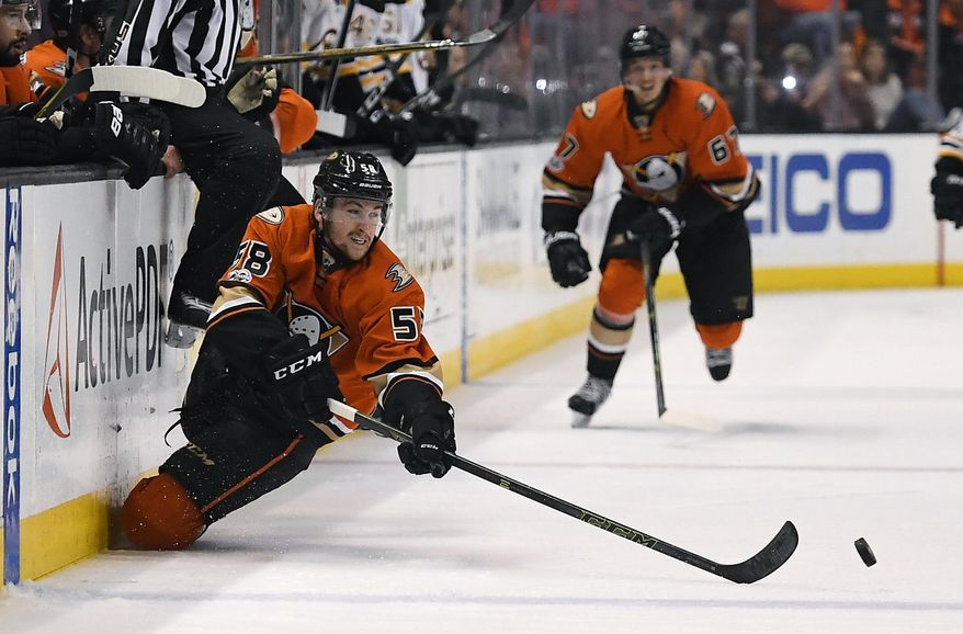 Anaheim Ducks left wing Nicolas Kerdiles passes the puck as he falls during the second period of the team's NHL hockey game against the Boston Bruins, Wednesday, Feb. 22, 2017, in Anaheim, Calif. (AP Photo/Mark J. Terrill)